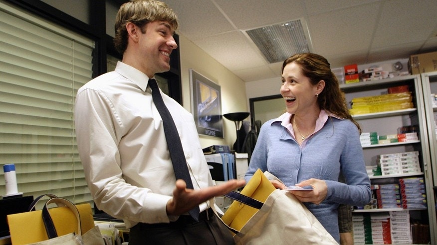 "Actors John Krasinski (L) and Jenna Fischer interact as they receive gift bags from the Screen Actors Guild Awards Committee including a certificate for their nomination for an outstanding performance by an ensemble in a comedy series in ""The Office,"" on the set of the television show ""The Office,"" in Panorama City, California, January 11, 2007."