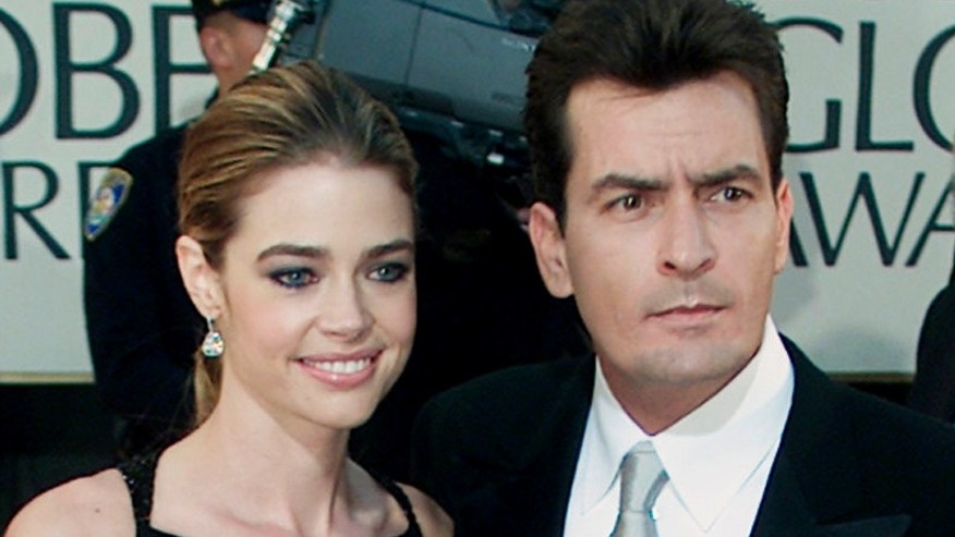 January 20, 2002. Charlie Sheen and fiance Denise Richards pose during arrivals at the 59th annual Golden Globe Awards in Beverly Hills.