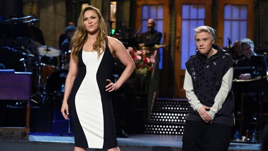 "SATURDAY NIGHT LIVE -- ""Ronda Rousey"" Episode 1694 -- Pictured: (l-r) Ronda Rousey and Kate McKinnon as Justin Bieber during the monologue on January 23, 2016 -- (Photo by: Dana Edelson/NBC)"