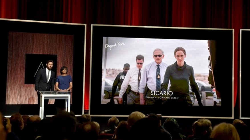 LOS ANGELES, CA - JANUARY 14:  Actor John Krasinski and President of the Academy of Motion Picture Arts and Sciences Cheryl Boone Isaacs announce 'Sicario' as a nominee for Best Music - Original Score during the 88th Oscars Nominations Announcement at the Academy of Motion Picture Arts and Sciences on January 14, 2016 in Los Angeles, California.  (Photo by Kevin Winter/Getty Images)