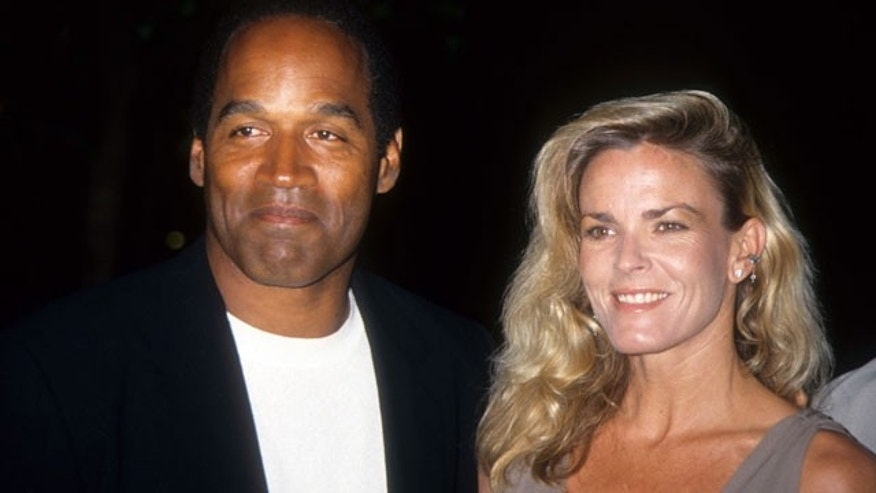 "LOS ANGELES - MARCH 16:  O.J. Simpson and Nicole Brown Simpson pose at the premiere of the ""Naked Gun 33 1/3: The Final Isult"" in which O.J. starred on March 16, 1994 in Los Angeles, California.  (Photo by Vinnie Zuffante/Archive Photos/Getty Images)"