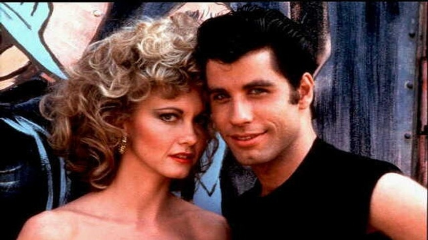 "Olivia Newton-John, left, and John Travolta in ""Grease."" AP"