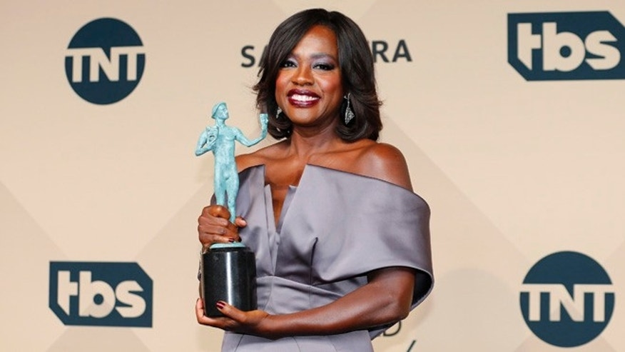 "January 30, 2016. Viola Davis holds the award for Outstanding Performance by a Female Actor in a Drama Series for her role in ""How to Get Away With Murder"" during the 22nd Screen Actors Guild Awards in Los Angeles."