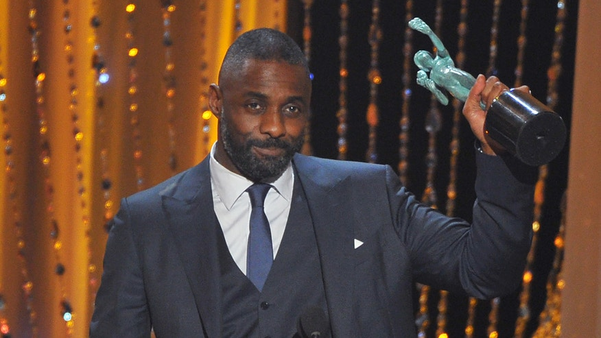Idris Elba accepts the award for outstanding male actor in a supporting role for Beasts of No Nation at the 22nd annual Screen Actors Guild Awards.