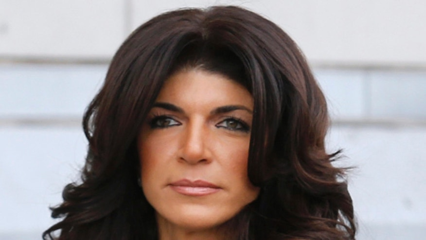 March 4, 2014. Teresa Giudice, 41, exits the Federal Court in Newark, New Jersey.