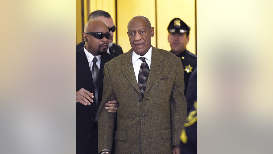 Actor and comedian Bill Cosby, center, arrives for a court appearance Tuesday, Feb. 2, 2016, in Norristown, Pa. Cosby was arrested and charged with drugging and sexually assaulting a woman at his home in January 2004. (Clem Murray/The Philadelphia Inquirer via AP, Pool)
