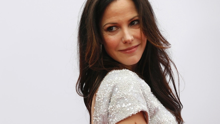 "Cast member Mary-Louise Parker poses at the premiere of the film ""Red 2"" in Los Angeles, California July 11, 2013. The movie opens in the U.S. on July 19."