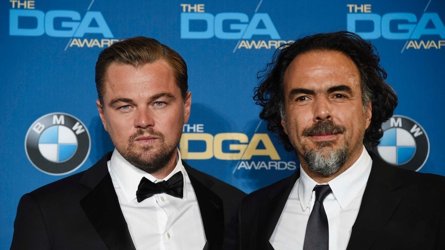 "Leonardo DiCaprio, left, star of ""The Revenant,"" poses backstage with the film's director Alejandro Gonzalez Inarritu at the 68th Directors Guild of America Awards at the Hyatt Regency Century Plaza on Saturday, Feb. 6, 2016 in Los Angeles. (Photo by Chris Pizzello/Invision/AP)"