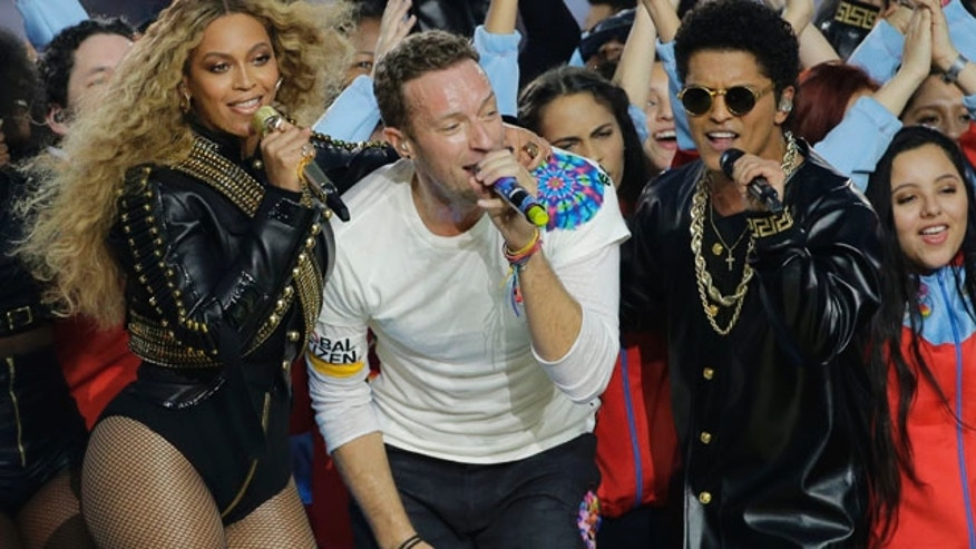 Feb. 7, 2016: Beyoncé, Coldplay singer Chris Martin and Bruno Mars perform during halftime of Super Bowl 50 in Santa Clara, Calif. (AP Photo/David J. Phillip)