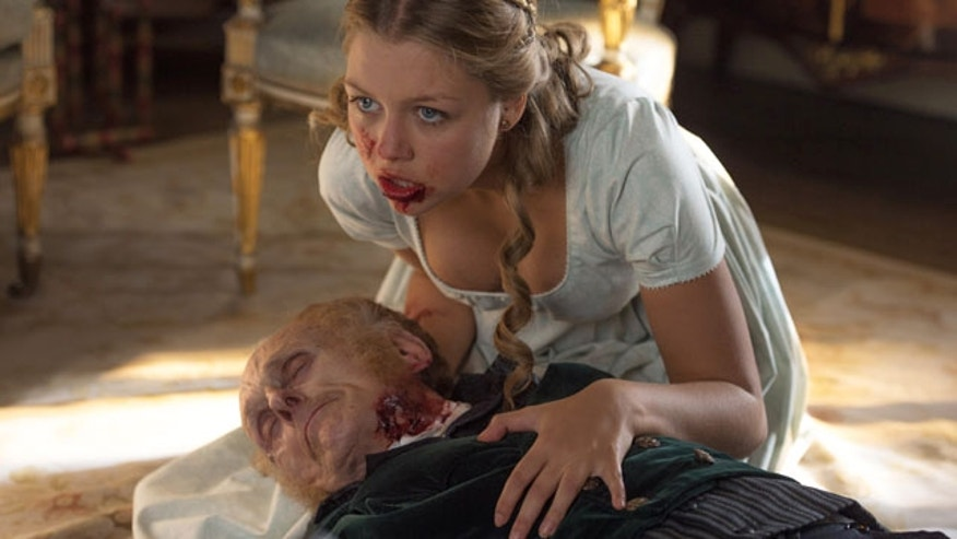 "This image released by Screen Gems shows Jess Radomska in a scene from ""Pride and Prejudice and Zombies."" (Jay Maidment/Screen Gems, Sony via AP)"