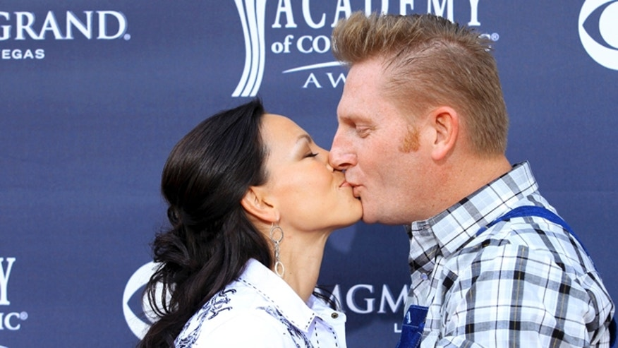 April 3, 2011. Rory Lee Feek (L) and Joey Martin Feek of country music duo Joey + Rory kiss at the 46th annual Academy of Country Music Awards in Las Vegas.