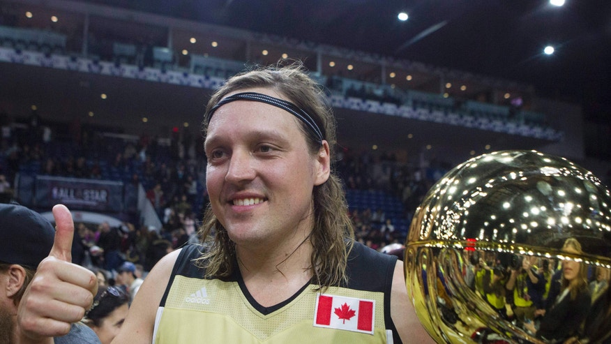 Feb. 12, 2016: Canada's Win Butler. of Arcade Fire, holds the MVP trophy after Canada defeated the United States in the Celebrity Game, part of NBA basketball's All-Star weekend, in Toronto.