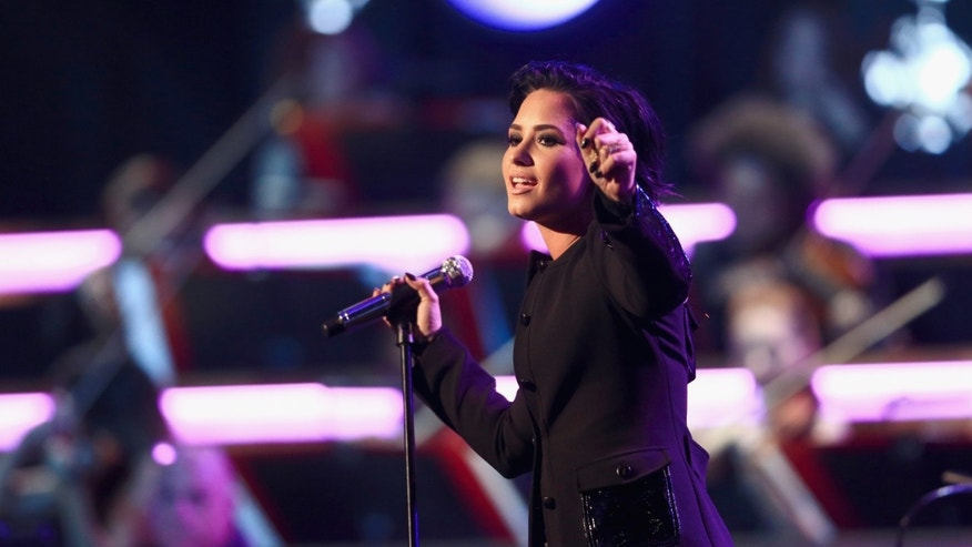 LOS ANGELES, CA - FEBRUARY 13:  Singer Demi Lovato performs onstage during the 2016 MusiCares Person of the Year honoring Lionel Richie at the Los Angeles Convention Center on February 13, 2016 in Los Angeles, California.  (Photo by Christopher Polk/Getty Images for NARAS)