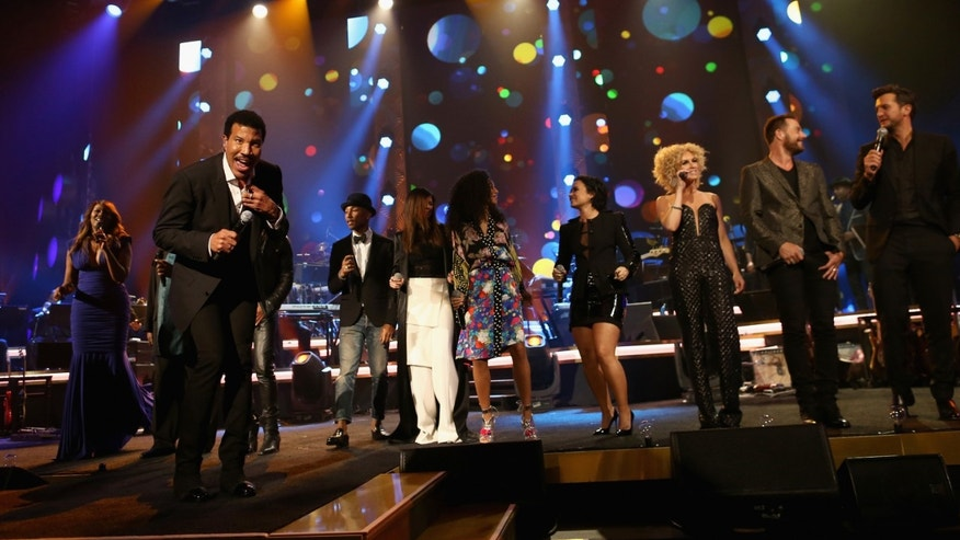 LOS ANGELES, CA - FEBRUARY 13:  (L-R) Singer Yolanda Adams, honoree Lionel Richie, singer Pharrell Williams, singer Karen Fairchild, singer Corrine Bailey Rae, singer Demi Lovato, singer Kimberly Schlapman, singerJimi Westbrook and singer Luke Bryan perform onstage during the 2016 MusiCares Person of the Year honoring Lionel Richie at the Los Angeles Convention Center on February 13, 2016 in Los Angeles, California.  (Photo by Christopher Polk/Getty Images for NARAS)