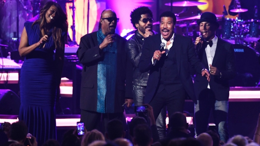 Feb 13, 2016. Honoree Lionel Richie performs at the MusiCares Person of the Year tribute at the Los Angeles Convention Center. Pictured from left are Yolanda Adams, Stevie Wonder, Lenny Kravitz and Pharrell Williams.