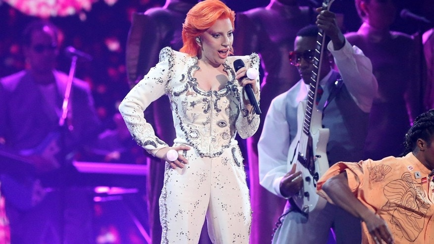 Lady Gaga performs a tribute to David Bowie at the 58th annual Grammy Awards on Monday, Feb. 15, 2016, in Los Angeles.