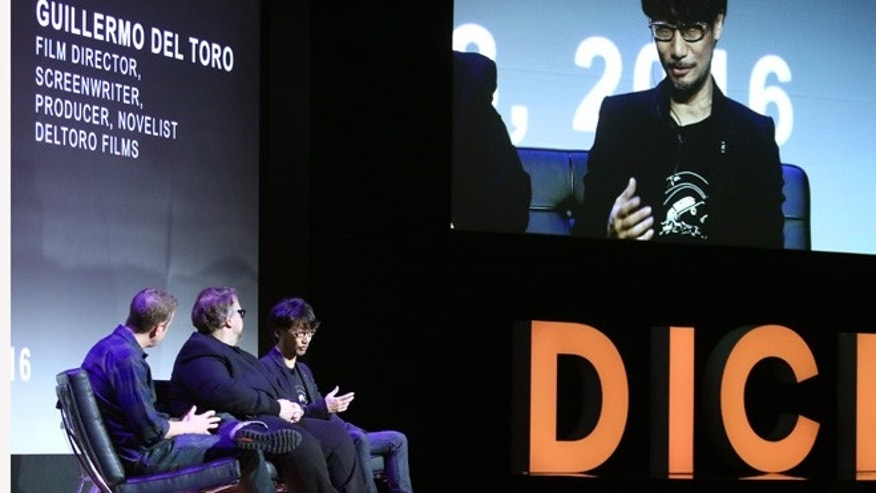 Hideo Kojima, from right, game designer at Kojima Productions, Guillermo del Toro, film director at DelToro Films, and Geoff Keighley, president of GameSlice, participate in a panel discussion at the D.I.C.E. Summit Thursday, Feb. 18, 2016, in Las Vegas. (AP Photo/Ronda Churchill)