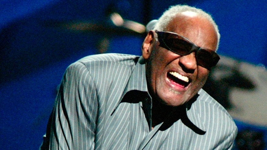 April 9, 2003. Ray Charles takes a bow after he sang with Willie Nelson at a concert in New York City.