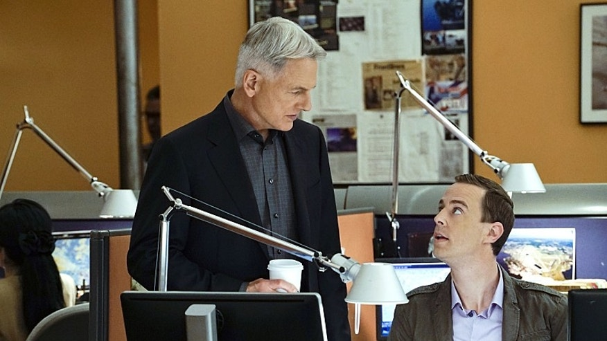 """Loose Cannons"" -- Dinozzo pays Jeanne Benoit (Scottie Thompson) a visit as he chases a lead involving doctors in Sudan, on NCIS, Tuesday, Feb. 23 (8:00-9:00 PM, ET/PT), on the CBS Television Network. Pictured left to right: Mark Harmon and Sean Murray  Photo: Cliff Lipson/CBS ©2016 CBS Broadcasting, Inc. All Rights Reserved"
