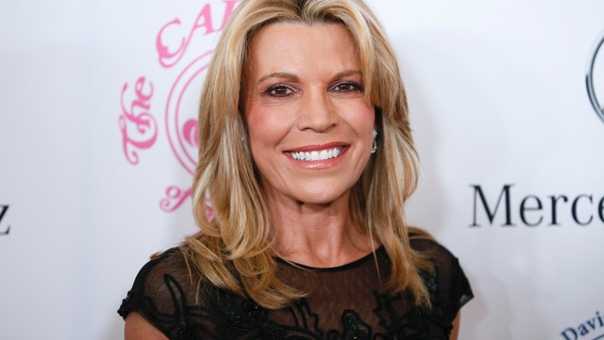 Television personality Vanna White poses at The Mercedes-Benz Carousel of Hope Ball to benefit the Barbara Davis Center for Diabetes in Beverly Hills, California October 11, 2014.