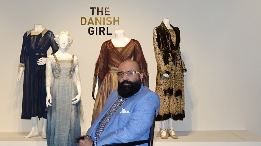 "Oscar-nominated designer Paco Delgado sits in front of his costume designs for ""The Danish Girl."""