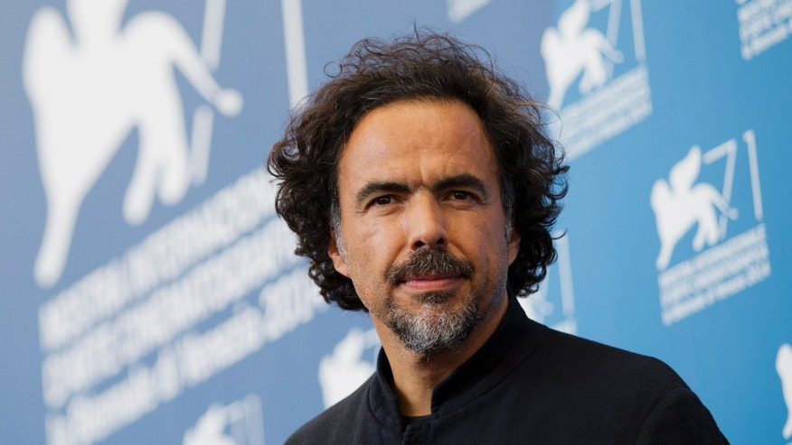 "FILE - In this Aug. 27, 2014 file photo, director Alejandro Inarritu poses during a photo call for the movie ""The Birdman"" at the 71st edition of the Venice Film Festival in Venice, Italy. (AP Photo/Andrew Medichini, File)"