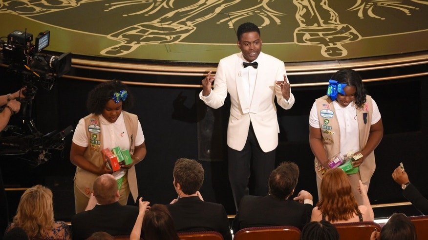 Host Chris Rock sells Girl Scout cookies in the audience at the Oscars on Sunday, Feb. 28, 2016, at the Dolby Theatre in Los Angeles. (Photo by Chris Pizzello/Invision/AP)