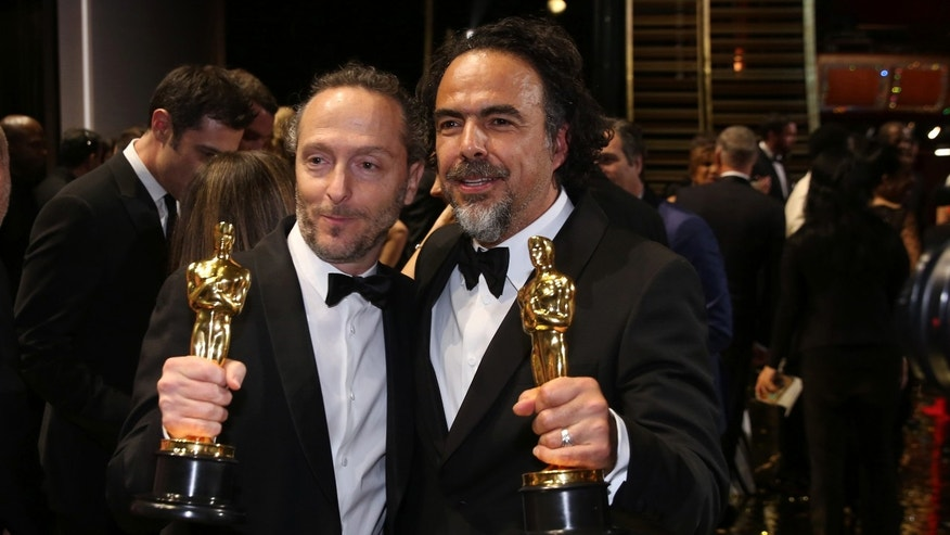 Emmanuel Lubezki and Alejandro G. Inarritu appear backstage at the Oscars on Sunday, Feb. 28, 2016.