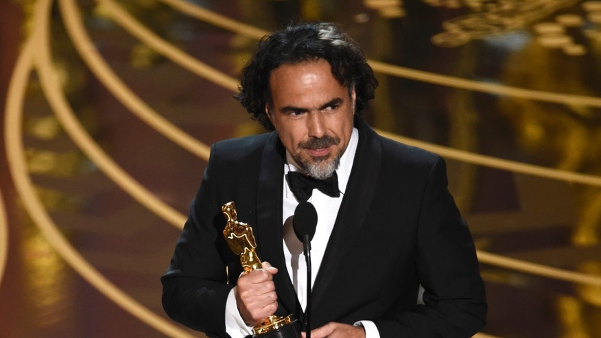 Alejandro G. Inarritu accepts the award for best director for The Revenant at the Oscars on Sunday, Feb. 28, 2016, at the Dolby Theatre in Los Angeles. (Photo by Chris Pizzello/Invision/AP)