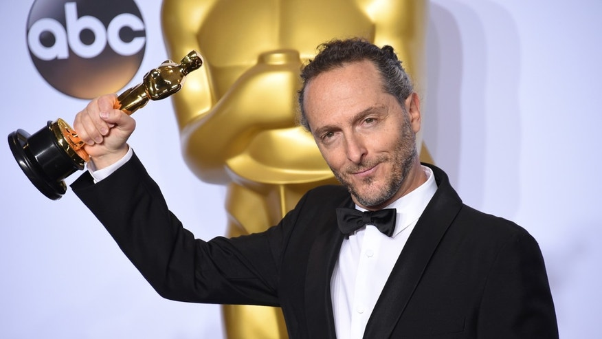 Emmanuel Lubezki poses with the award for best cinematography for The Revenant in the press room at the Oscars on Sunday, Feb. 28, 2016, at the Dolby Theatre in Los Angeles. (Photo by Jordan Strauss/Invision/AP)