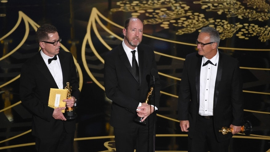 Gregg Rudloff, from left, Chris Jenkins, and Ben Osmo accept the award for best sound mixing for Mad Max: Fury Road at the Oscars on Sunday, Feb. 28, 2016, at the Dolby Theatre in Los Angeles. (Photo by Chris Pizzello/Invision/AP)
