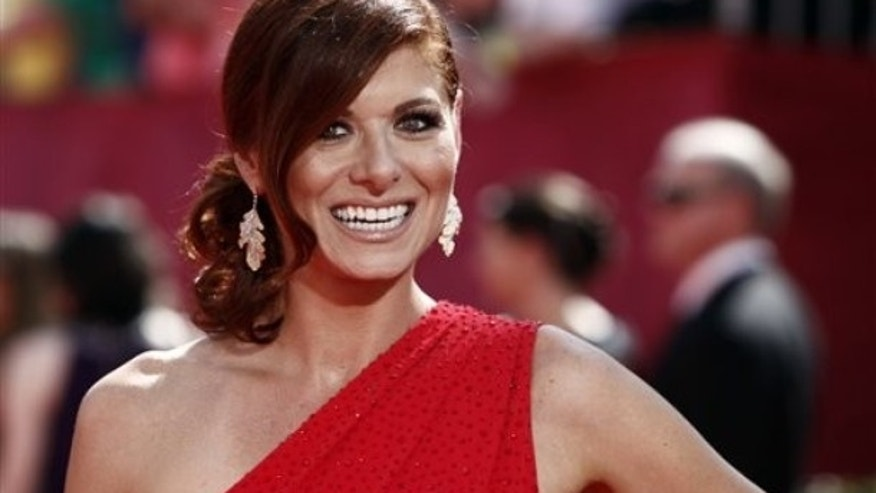 Debra Messing arrives at the 61st Primetime Emmy Awards on Sunday, Sept. 20, 2009, in Los Angeles. (AP Photo/Matt Sayles)