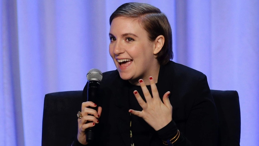 "In this Tuesday, Feb. 2, 2016 photo, writer and actress Lena Dunham speaks during a panel entitled ""Media with Purpose"" at the American Magazine Media 360 Conference in New York."