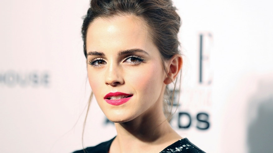Actress Emma Watson arrives at the Elle Style Awards in London, February 18, 2014. REUTERS/Paul Hackett (BRITAIN - Tags: ENTERTAINMENT) - RTX192QR