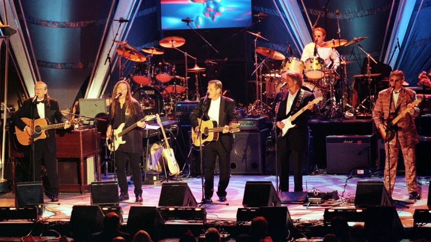 The Eagles perform at the band's induction into the Rock and Roll Hall of Fame on Jan. 13, 1998. Band members are (L-R) Randy Meisner, Timothy B. Schmidt, Glen Frey, Don Felder, Joe Walsh and Don Henley (rear). REUTERS