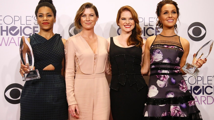 ABC drama series Grey's Anatomy cast (L-R) Kelly McCreary, Ellen Pompeo, Sarah Drew and Camilla Luddington pose backstage with the awards for Favorite TV Drama and Favorite TV Character We Miss Most during the 2015 People's Choice Awards in Los Angeles, California January 7, 2015.