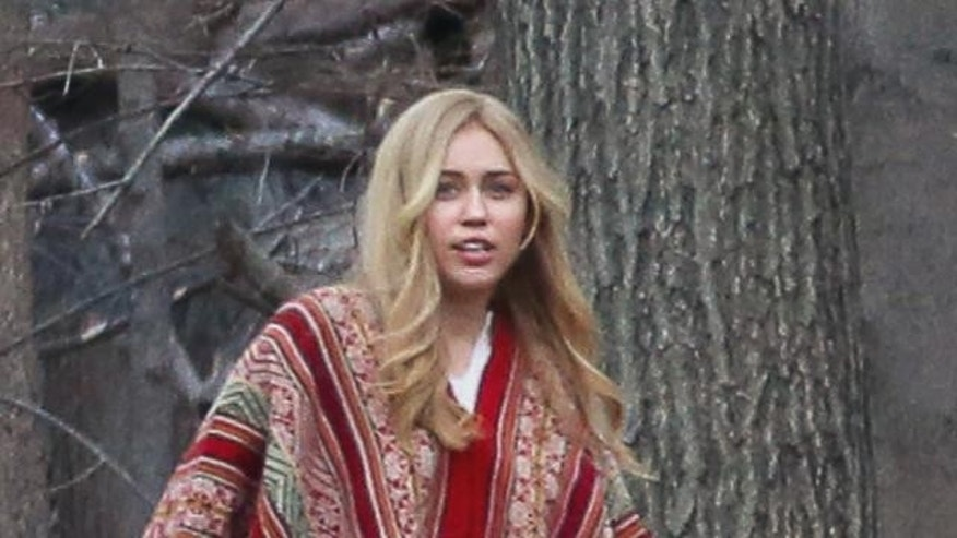 Miley Cyrus on the set of Woody Allen's new television series.
