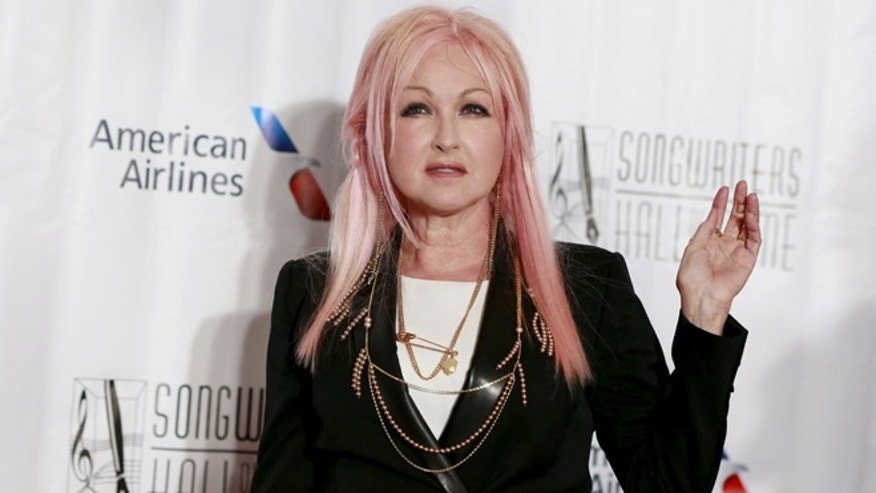 June 18, 2015. Singer Cyndi Lauper poses on the red carpet before the Songwriters Hall of Fame ceremony in New York.