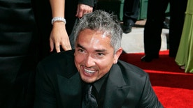 Aug. 19, 2006. Television personality and dog psychologist Cesar Milan arrives for the Creative Arts Emmy Awards in Los Angeles.