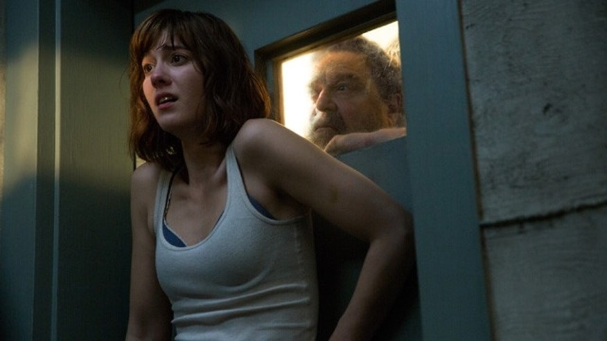 This image released by Paramount Pictures shows Mary Elizabeth Winstead, left, and John Goodman in a scene from the film, '10 Cloverfield Lane.' (Michele K. Short/Paramount Pictures via AP)