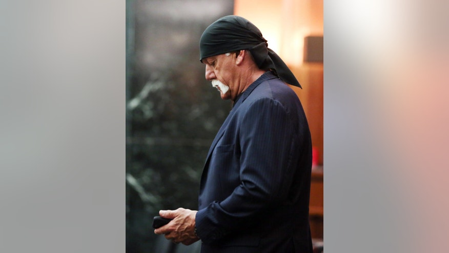 Hulk Hogan, whose given name is Terry Bollea, enters a Pinellas County courtroom, Monday, March 14, 2016, in St Petersburg, Fla. Hogan is suing Gawker Media for $100 million for posting an edited video showing him having sex with his then-best friend's wife. Lawyers for Gawker Media began presenting their case on Monday. (Stephen Yang/ New York Post via AP, Pool)