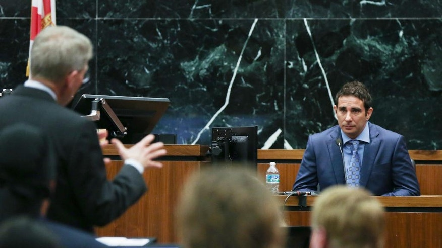 Former Gawker employee A.J. Daulerio, right, testifies at the Pinellas County Courthouse in St. Petersburg, Fla., Monday, March 14, 2016. Hulk Hogan is suing Gawker Media for $100 million for posting an edited video showing him having sex with his then-best friend's wife. Lawyers for Gawker Media began presenting their case on Monday. (Stephen Yang/New York Post via AP, Pool)