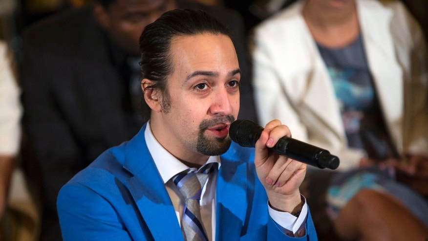 "In this March 14, 2016 photo, Actor Lin-Manuel Miranda speaks during an event with the cast of the Broadway play ""Hamilton"" in the East Room of the White House in Washington.  Americas first Treasury secretary says its time for Congress to help dig Puerto Rico out of its debt crisis. And if it will help make the case, hes even got tickets to Broadways latest mega-hit.  Alexander Hamilton, actually Lin-Manuel Miranda, who created the show and plays Hamilton, told reporters on Capitol Hill Tuesday that lawmakers must pass legislation that would let the U.S. territory restructure its $72 billion debt.  (AP Photo/Evan Vucci)"