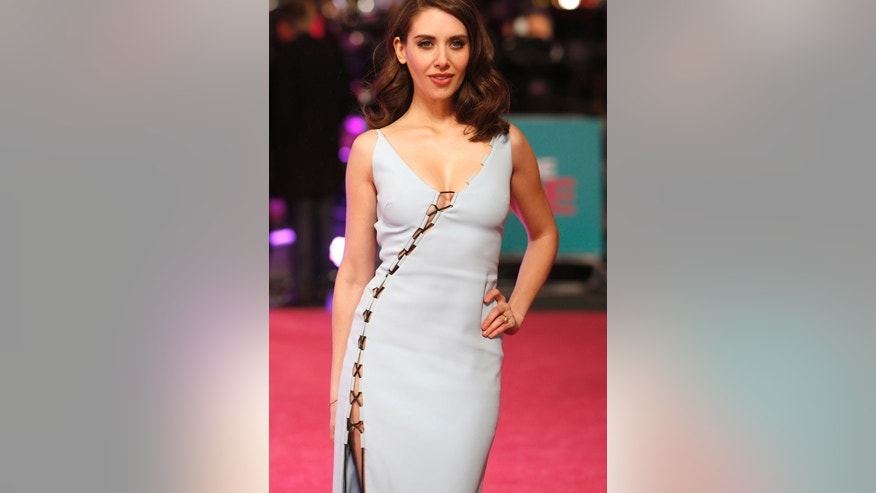 """U.S. actress Alison Brie poses for photographers at the European premiere of the film """"How to be Single"""" in London, Britain February 9, 2016."""