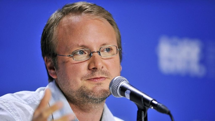"Sept. 6, 2012. Writer-director Rian Johnson speaks about his movie ""Looper"" during a news conference at the 2012 Toronto International Film Festival in Toronto."