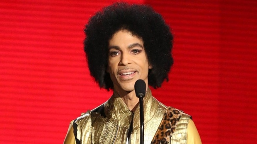 Nov. 22, 2015. Prince presents the award for favorite album - soul/R&B at the American Music Awards in Los Angeles.