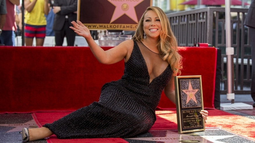 August 5, 2015. Mariah Carey poses with her star after it was unveiled on the Hollywood Walk of Fame in Los Angeles.