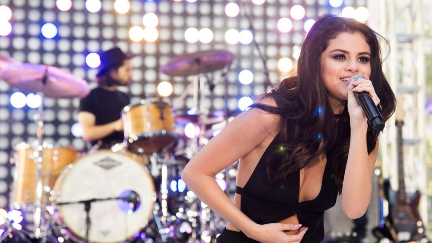 "FILE - In this Monday, Oct. 12, 2015, file photo, Selena Gomez performs on NBC's ""Today"" show at Rockefeller Plaza in New York. Gomez, Carrie Underwood and 5 Seconds of Summer will be performing at the American Music Awards, on Nov. 22, 2015, at the Microsoft Theater in Los Angeles. (Photo by Charles Sykes/Invision/AP, File)"
