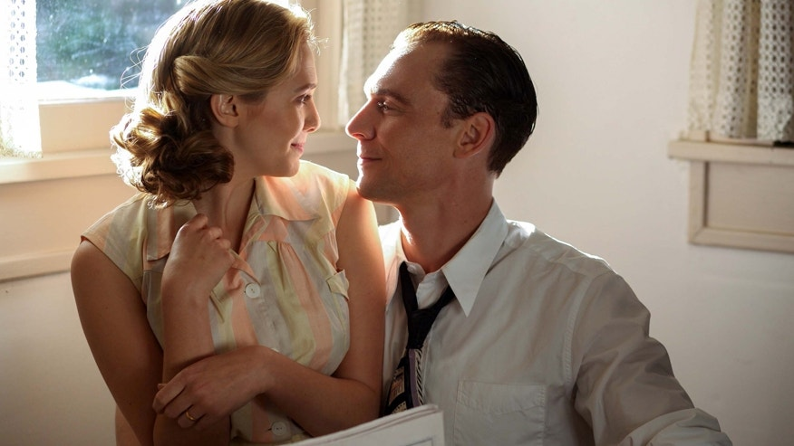 "This image released by Sony Pictures Classics shows Elizabeth Olsen as Audrey Williams, left, and Tom Hiddleston as Hank Williams in a scene from, ""I Saw The Light."""