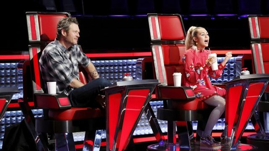 "Miley Cyrus on ""The Voice"" with Blake Shelton."